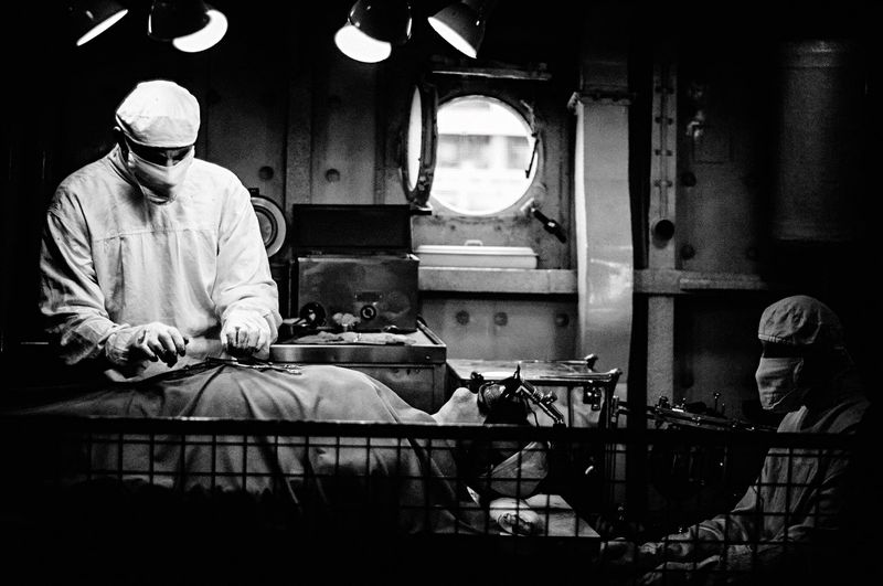 Surgeon Operating Patient In Hospital