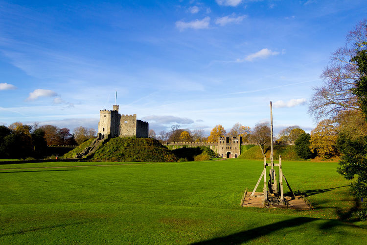 Daytime Wales Built Structure Castle Day Field Fort Grass Green Color Landscape No People Outdoors Sky Travel Destinations Trebuchet