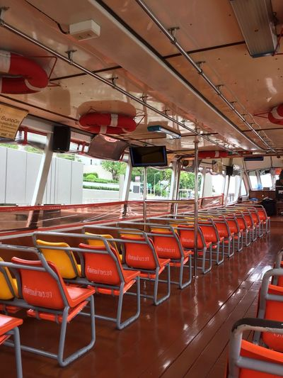 Empty chairs in boat