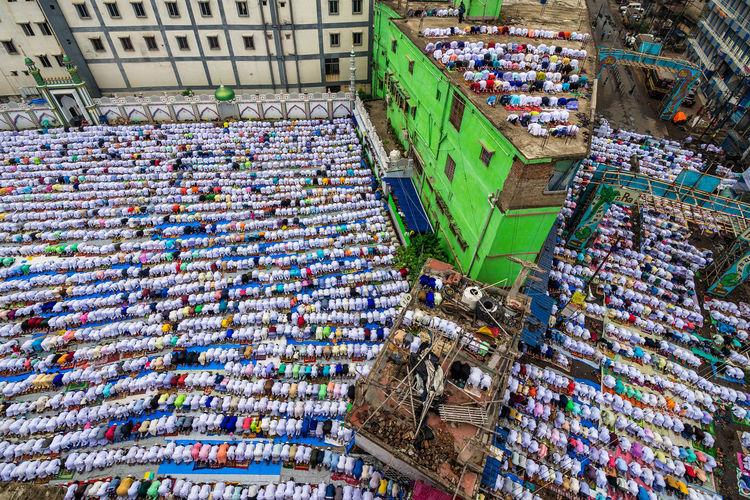 High angle view of islamic men praying outdoors