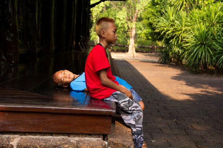 Boy sitting on porch