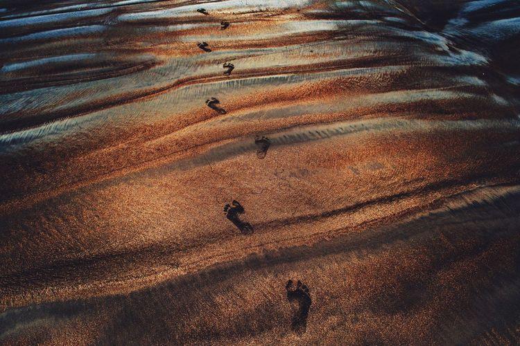 High angle view of shadow on sand