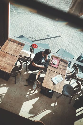 High angle view of man working on table