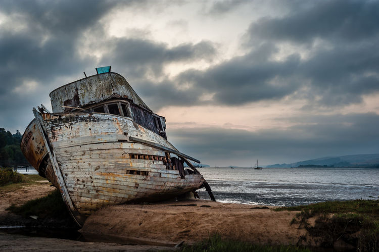 Point Reyes Abandoned Beach Beauty In Nature Boat Cloud - Sky Clouds Damaged Desolate Horizon Over Water Mode Of Transport Moored Nature Nautical Vessel No People Outdoors Rusty Sand Sea Ship Shipwreck Sinking Sky Storm Cloud Sunken Tranquility Transportation Water