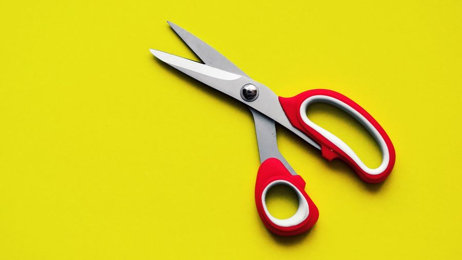 Scissors Still Life Studio Shot Indoors  No People Close-up Colored Background Yellow Work Tool Sharp Yellow Background Cut Out Copy Space Red Metal Equipment Single Object Variation Craft Art And Craft