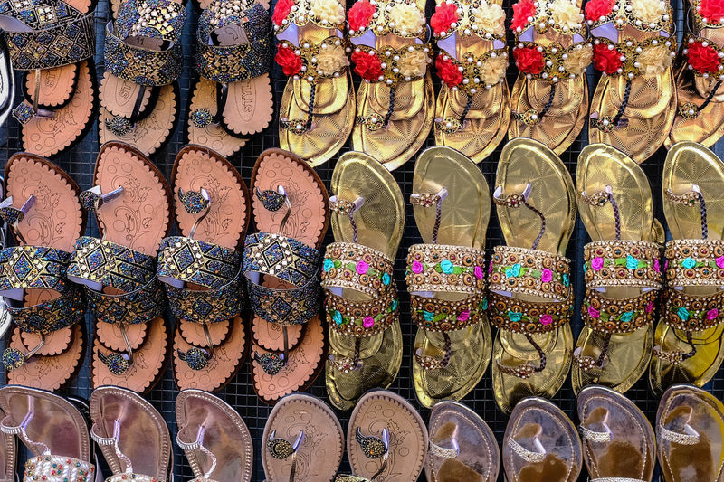Arrangement In A Row Choice Variation Large Group Of Objects For Sale Side By Side Retail  Abundance Full Frame Order No People Market Multi Colored Still Life Retail Display Small Business Market Stall Art And Craft Store Sale Shoes Cultural Pakistan