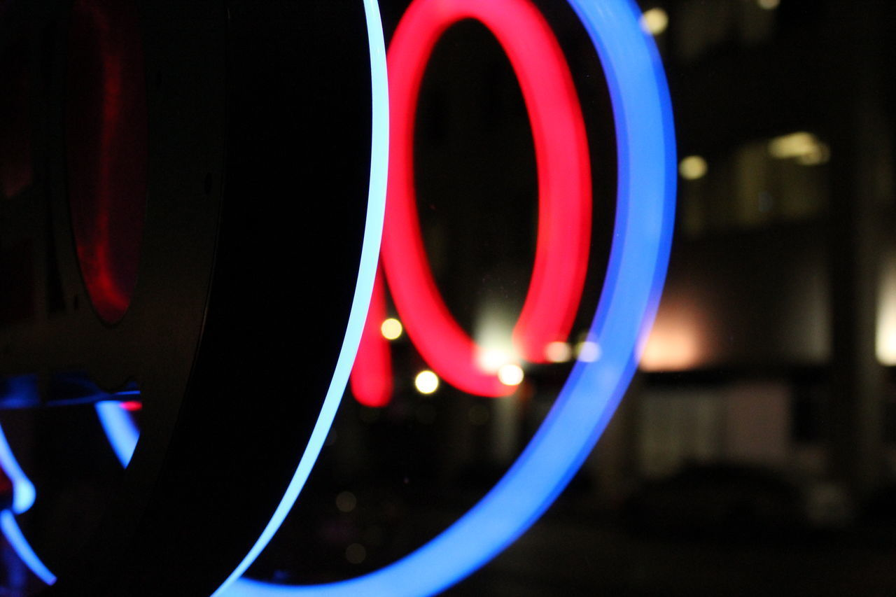 illuminated, close-up, geometric shape, no people, circle, focus on foreground, glowing, shape, night, red, indoors, multi colored, pattern, lighting equipment, design, technology, light - natural phenomenon, motion, blue, electrical equipment