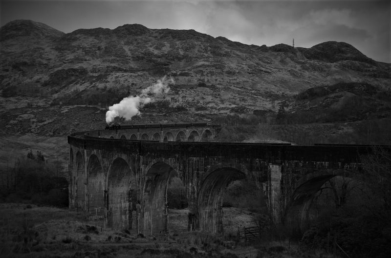 Architecture Beautiful Beauty In Nature Black And White Bridge Glenfinnan Glenfinnan Viaduct Jacobite Mountain Scotland Smoke Steam Steam Train Train Long Goodbye EyeEmNewHere Farewell The Great Outdoors - 2017 EyeEm Awards Live For The Story The Week On EyeEm Been There. It's About The Journey