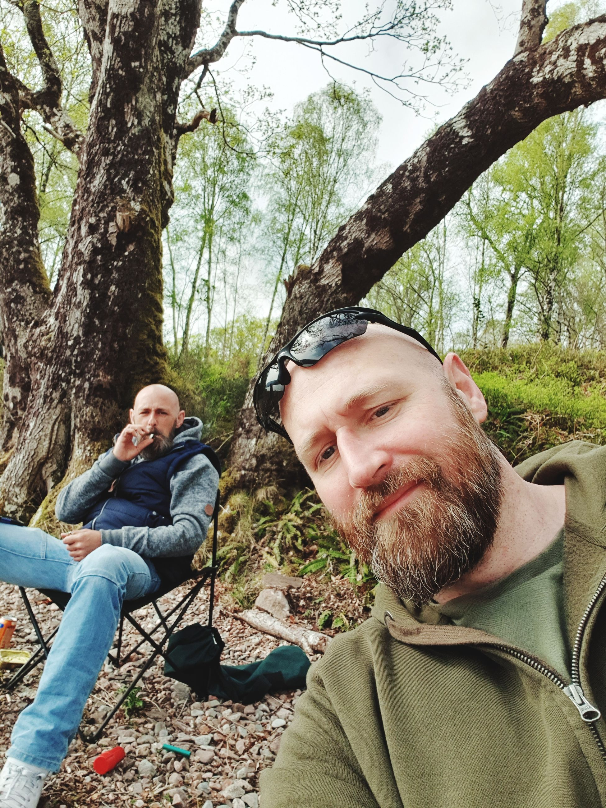 tree, plant, men, males, real people, sitting, mid adult, leisure activity, mid adult men, facial hair, lifestyles, adult, beard, forest, casual clothing, nature, smiling, people, young men, mature men, mature adult, outdoors
