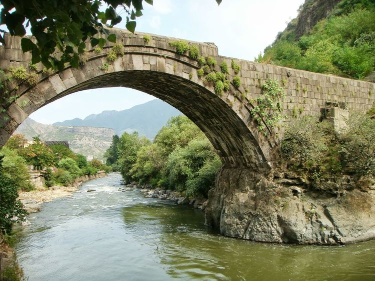 Ancient arch bridge to Alaverdi in Armenia Nature Travel Destination Reflections In The Water Mountains In Distance Armenia Alaverdi Bridge Ancient Water Day No People Bridge - Man Made Structure Tree Nature Landscape Outdoors Sky Stream - Flowing Water Arch Bridge Footbridge Flowing Old Ruin Ancient Civilization Ancient