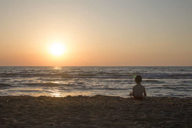 Beach Beauty In Nature Child Childhood Children Only Horizon Horizon Over Water Land Leisure Activity Lifestyles Looking At View Nature One Person Outdoors Real People Rear View Scenics - Nature Sea Sitting Sky Sun Sunset Tranquil Scene Tranquility Water HUAWEI Photo Award: After Dark
