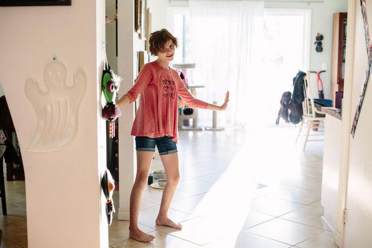 Portrait of child standing on floor in building