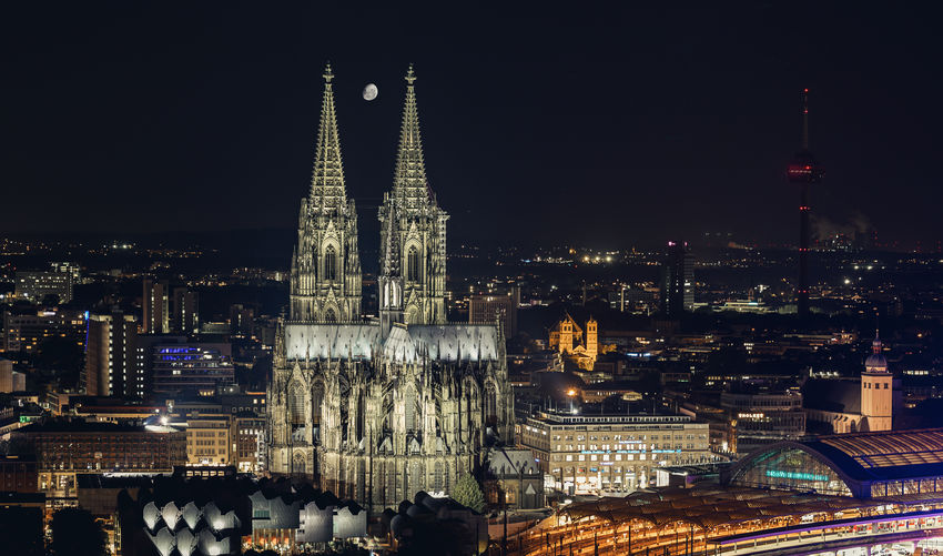 Cologne Cathedral close-up at night with half moon Cathedral Cologne Moon Aerial View Architecture Building Exterior Built Structure City Cityscape Cologne Cathedral Germany Half Moon Illuminated Landmark Modern Moonlight Night No People Outdoors Religion Skyscraper Spirituality Tourism Train Station Travel Destinations