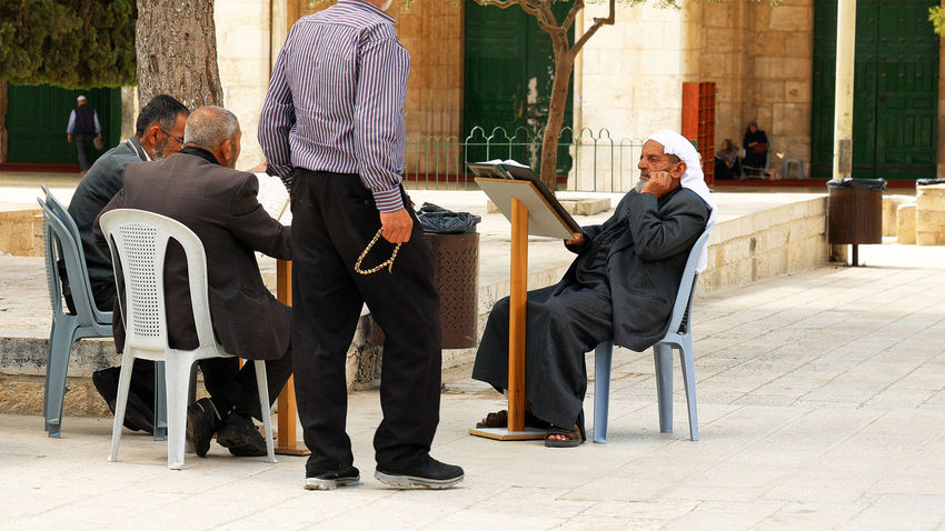 Adult Adults Only Arab Architecture Building Exterior Built Structure Chair Day Full Length Islam Leisure Activity Lifestyles Men Muslim Muslims Outdoors People Quran Real People Senior Adult Senior Men Senior Women Sitting Togetherness Two People An Eye For Travel The Street Photographer - 2018 EyeEm Awards The Photojournalist - 2018 EyeEm Awards
