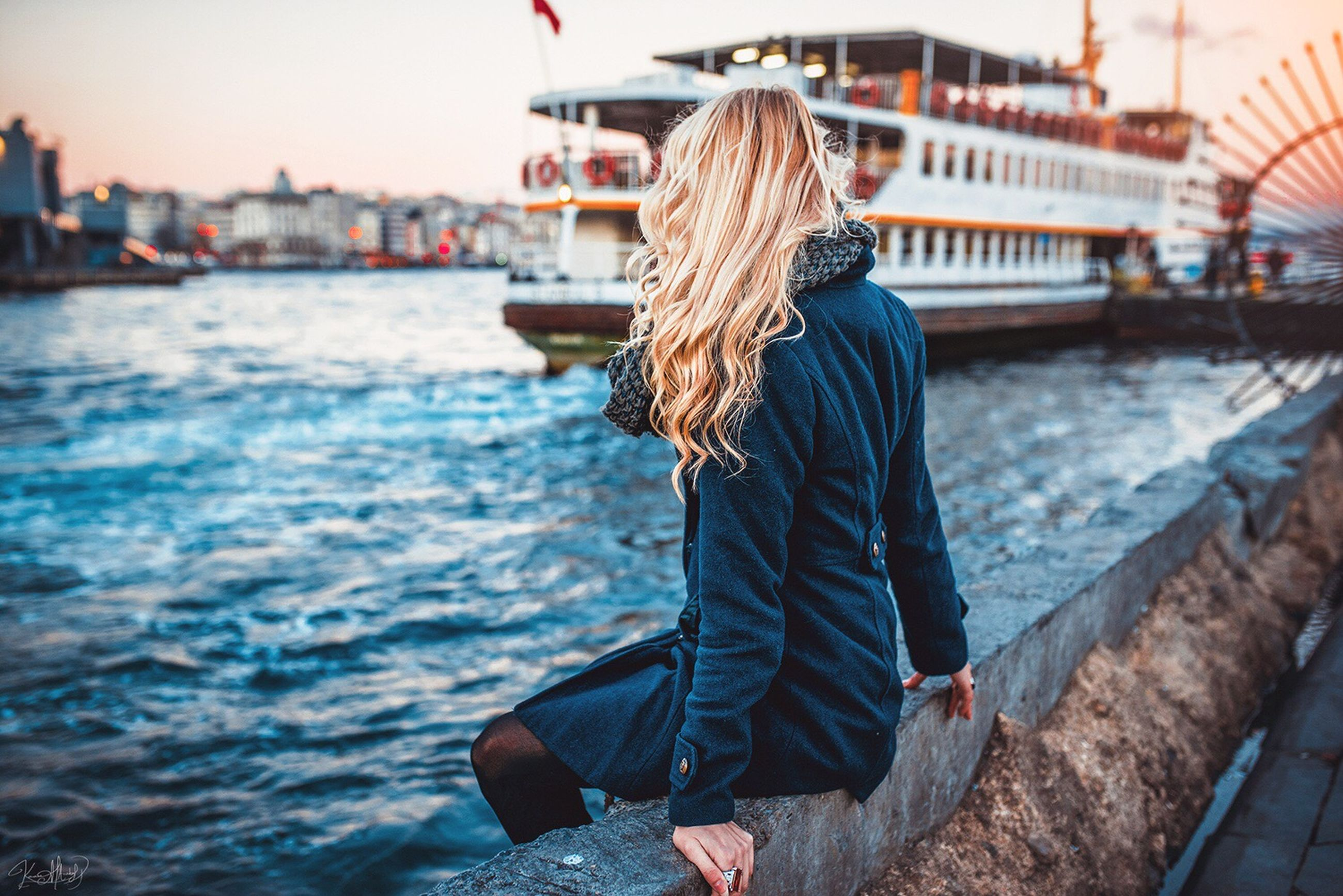 water, focus on foreground, lifestyles, rear view, sea, leisure activity, city, built structure, nautical vessel, person, river, building exterior, architecture, transportation, men, incidental people, harbor, outdoors