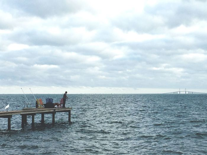 Man Fishing Dogs Ocean Body Of Water Sea Clouds And Sky Bridge Skylines Happy Relaxation Moments To Cherish Nature Outdoors Tranquility Men Horizon Over Water Fishing Pole Breathing Space