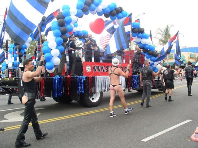 Adult Adults Only Celebration City Day Outdoors Parade People Performance Real People Spectator Text Two People