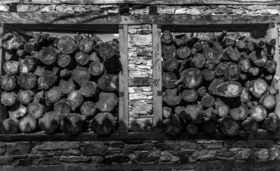 Abundance Architecture Arrangement Blackandwhite Built Structure Day Deforestation Firewood Forest Indoors  Large Group Of Objects Log Lumber Industry Nature No People Stack Stone Wall Timber Tree Wood Wood - Material