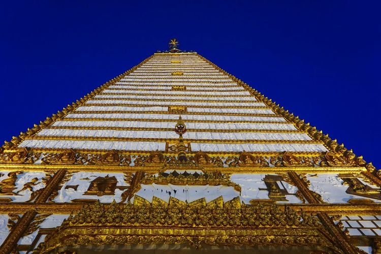 Low angle view of temple building against clear blue sky