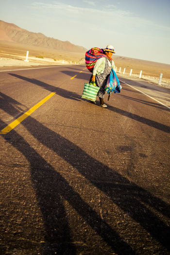 Crossing Nazca Peru Road Travel Woman Carry Crossing Dressed Long Road People South America The Longest Road Traditional First Eyeem Photo The Week On EyeEm The Week On EyeEm The Week On EyeEm