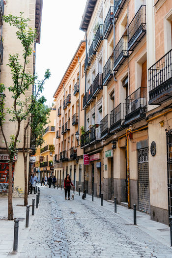 Urban scene in city centre quarter of Madrid Architecture City Centre Cityscape European  Lavapies  Madrid Rastro SPAIN Urban Scene Architecture Building Building Exterior Built Structure City City Life Day Europe Old Outdoors Real People Residential District Street Traditional Urban Skyline Walking