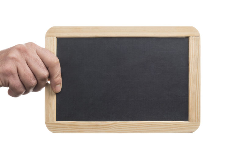 Cropped hand holding a blank slate board with wooden frame, isolated on white background Hand Holding Hold Blackboard  Chalkboard Board Chalk Empty Blank Copy Space Slate School Schooling Sign Matte Show Showing Message Idea Announcement Backgrounds White Background Display Wood Frame