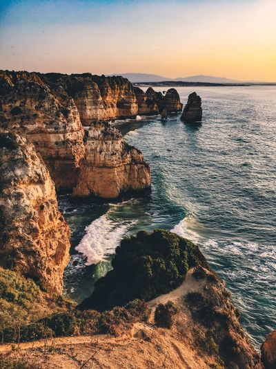 EyeEm Selects EyeEm Selects Rock Formation Sea Rock - Object Beauty In Nature Scenics Nature Tranquil Scene Water Tranquility Horizon Over Water Rock Idyllic Sunset Sky No People Cliff Outdoors Day Portugal Algarve Been There. Lost In The Landscape