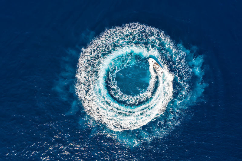 Motorboat performs a circle of bubbles on the ocean surface Bubbles Circle Fun Shape Blue Concept Day High Angle View Mode Of Transportation Motion Motorboat Nautical Vessel Outdoors Sea Seascape Shape Speed Speedboat Sport Transportation Water Waterfront Waves Yacht Yachting
