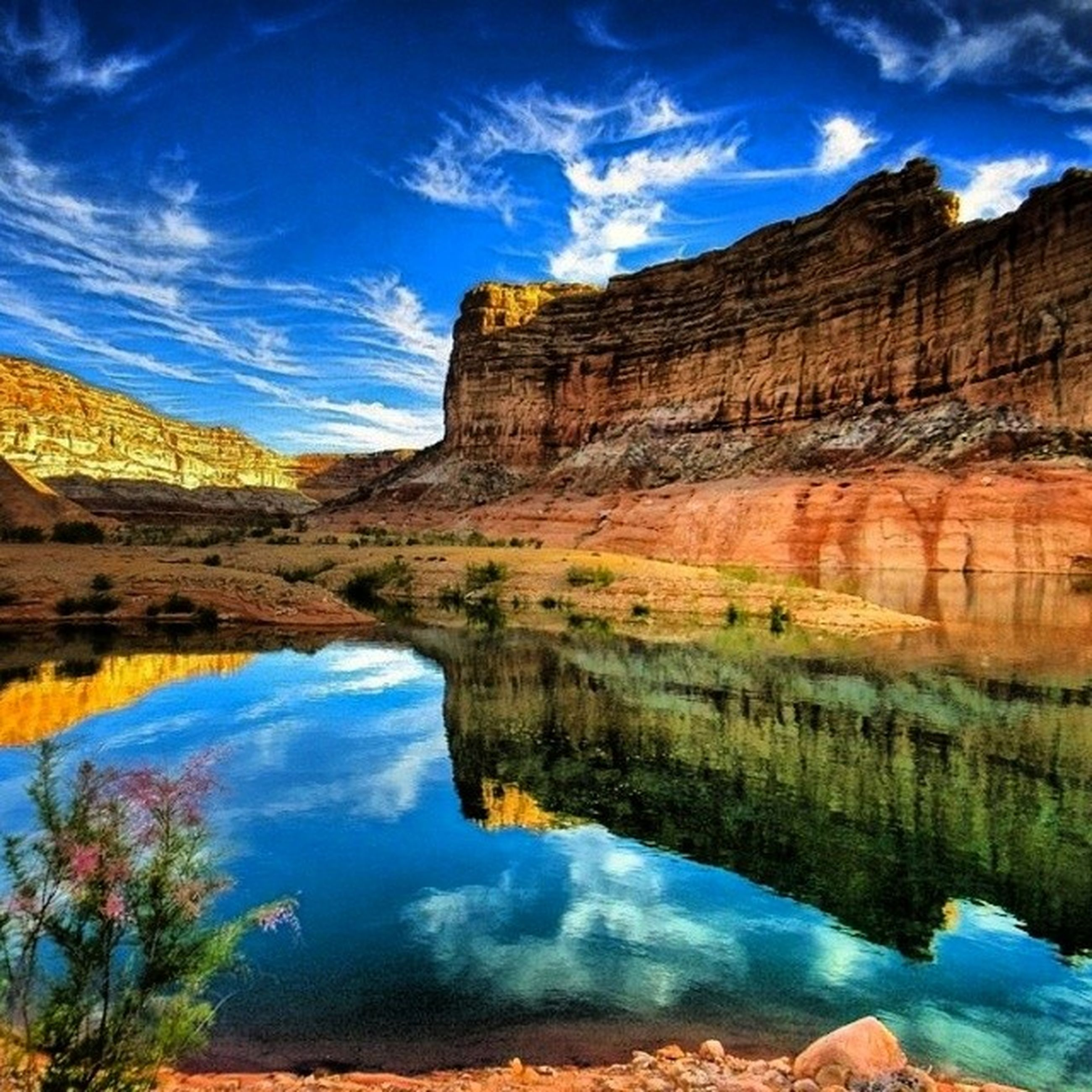 tranquil scene, tranquility, water, scenics, reflection, sky, beauty in nature, lake, nature, blue, cloud, cloud - sky, idyllic, rock formation, landscape, rock - object, standing water, mountain, non-urban scene, physical geography
