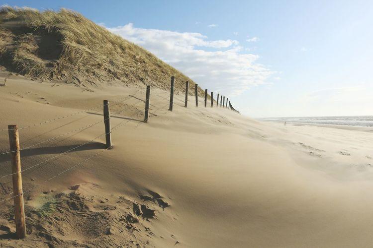 Fence on sand at beach