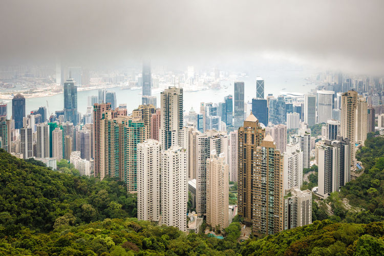 ASIA HongKong Architecture Building Exterior Built Structure City Cityscape Cloud - Sky Crowded Day Downtown District Futuristic Nature Outdoors People Sky Skyscraper Smog Tree Urban Skyline
