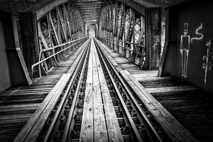 Empty railroad tracks in building