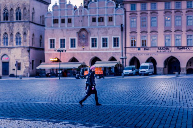 Full length of a man walking in city street