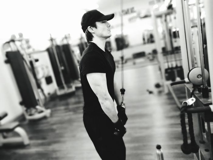 Side View Of Man Exercising In Gym