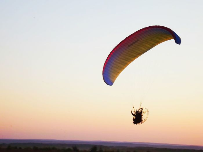 Low angle view of parachute flying in sky