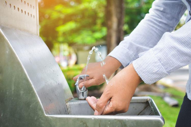 Close-up of man washing hands