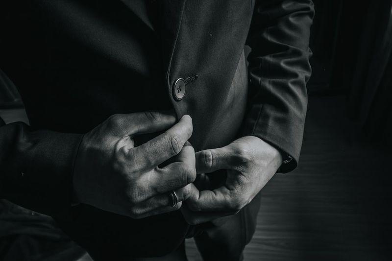 Midsection of businessman standing on hardwood floor