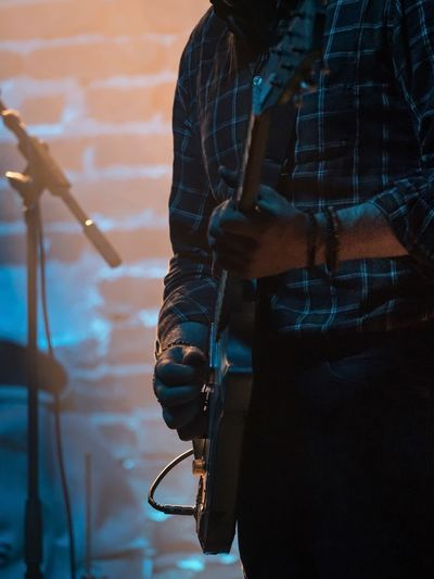 On Stage - Musicians in a Private Jazz Concert Jazz Concert Music On Stage Arts Culture And Entertainment Brickstone Building Close-up Club Concert Day Entertainment Guitar Guitar Player Guitarist Human Hand Indoors  Low Section Midsection Real People Stage - Performance Space Standing