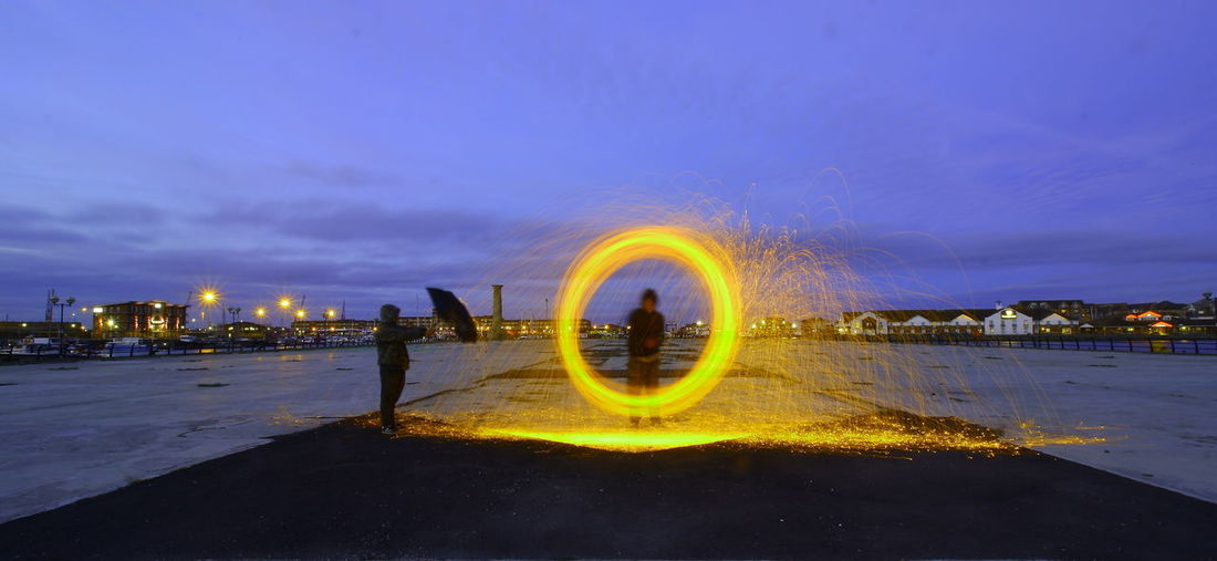 Man Spinning Wire Wool At Dusk