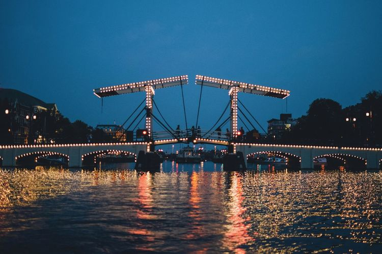 EyeEm Best Shots EyeEmNewHere EyeEm Selects EyeEm Gallery Water Architecture Built Structure Sky Waterfront Nature River Reflection Bridge Connection Bridge - Man Made Structure Illuminated No People Blue Clear Sky Outdoors Night Dusk Tourism Construction Equipment