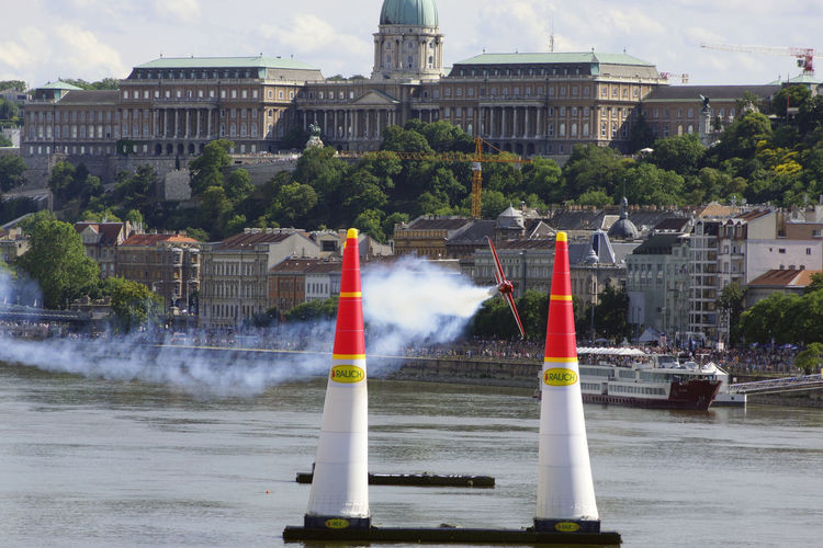 Red Bull Air Race Budapest 2017 Air Race Airplane Architecture Building Exterior Built Structure City Day Flight Fountain Motion No People Outdoors Sky Spraying Tree Water