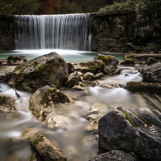 Flowing Water at Jenbachtal, Bad Feilnbach, GermanyWater Nature Scenics Waterfall Beauty In Nature Forest No People Rock - Object Outdoors Tree Day Freshness Flowing Power In NatureLong Exposure EyeEmNewHere Motion Still Life Hiking Tree Stones Travel Tranquility Wanderlust Longexposure