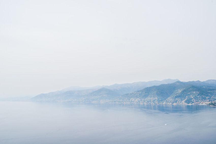 @ Portofino Regional Natural Park, Liguria, Italy Camogli Beauty In Nature Clear Sky Day Landscape Liguria Mist Mountain Mountain Range Nature No People Outdoors Punta Chiappa Scenics Sea Seaview Sky Tranquil Scene Tranquility Water Waterfront