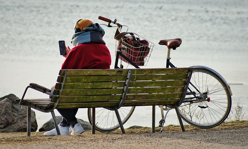 Rear view of man sitting on bicycle