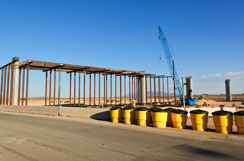 Taken in 2012. The early stages of construction for the Loop 303 Interchange that will link the Loop 303 with Interstate Highway 10 in Arizona. Arizona Construction Site Architecture Blue Bridge - Man Made Structure Bridge Construction Built Structure Clear Sky Crane - Construction Machinery Day No People Outdoors Sky Sunlight Transportation