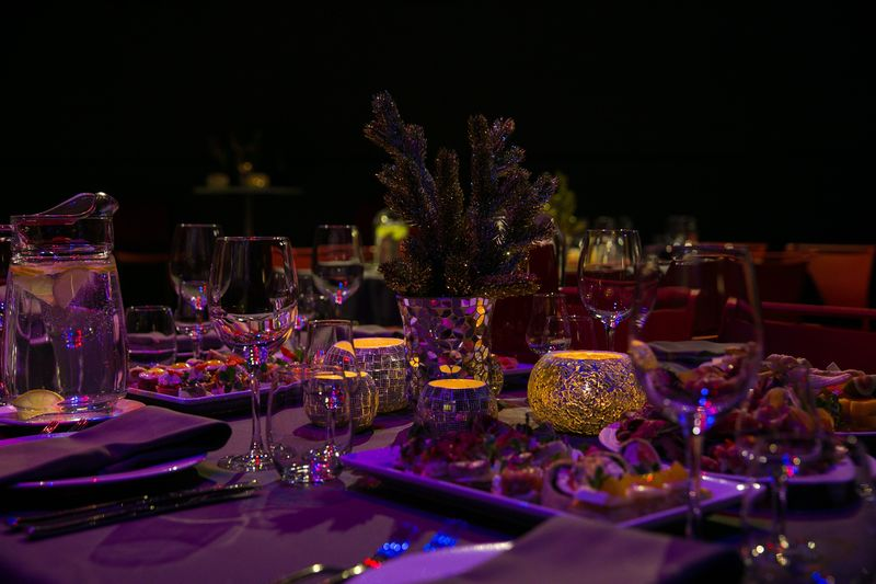 Panoramic view of dining table at night
