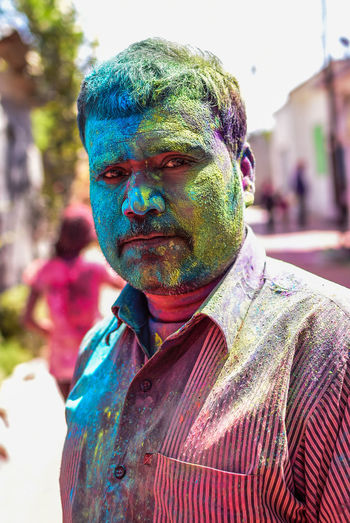 Close-up of man covered in paint powder