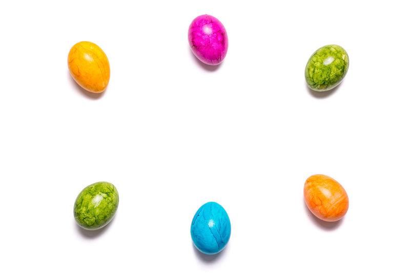 Green eggs on white background