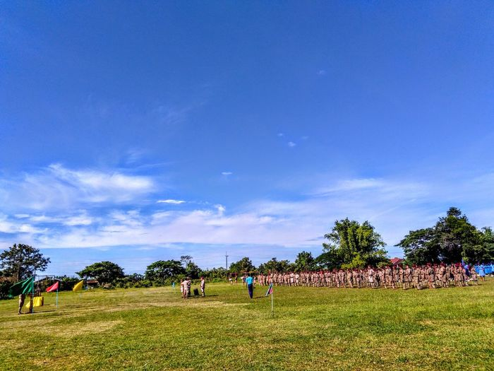 View of military training on field during sunny day