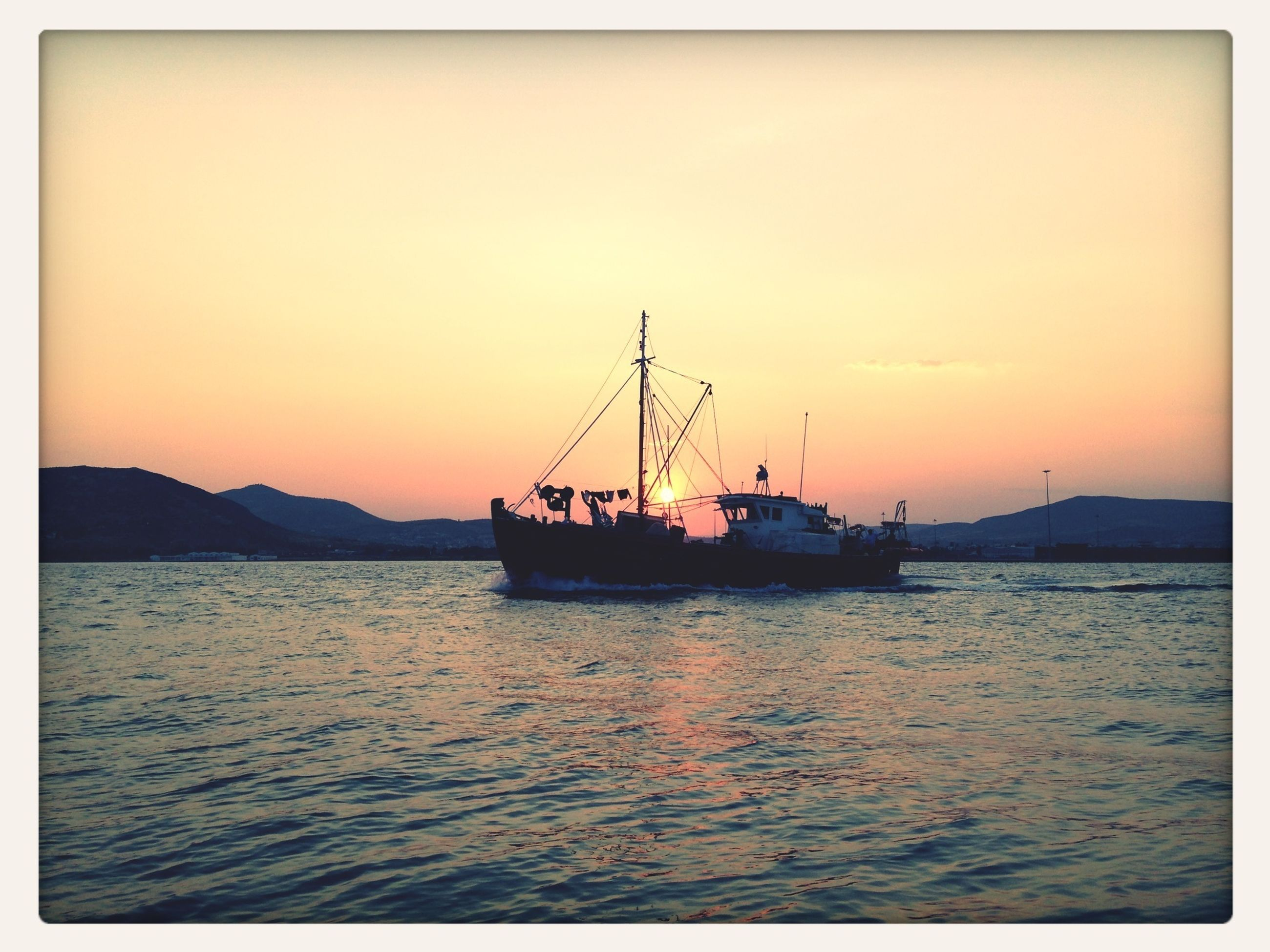 sunset, water, transfer print, nautical vessel, sea, transportation, silhouette, orange color, boat, scenics, beauty in nature, tranquility, mode of transport, auto post production filter, tranquil scene, sky, waterfront, sailboat, nature, mast